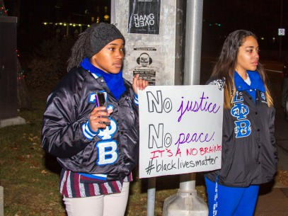 Two of the girls attending our protest Wednesday evening. Proud to stand with them. [Photo courtesy of The Collegian]